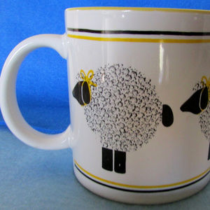 Lots of sheep Le Mouton coffee mug Dept. 56